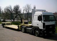 ВАРЗ-НПМ 1013.01  Одноосный полуприцеп-тяжеловоз  грузоподъемностью 15 400 кг.
