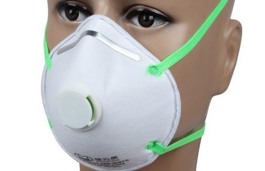 Респіратор для захисту від шкідливих парів і газів, з дихальним клапаном.