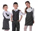 Школьная форма для мальчиков и девочек: блузки, сарафаны, юбки, костюмы, брюки.