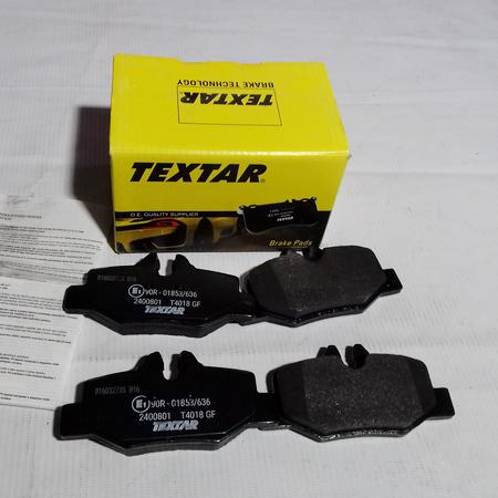 Задние тормозные колодки 0064204420. TEXTAR