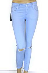 Жіночі літні голубі рвані брюки джинси