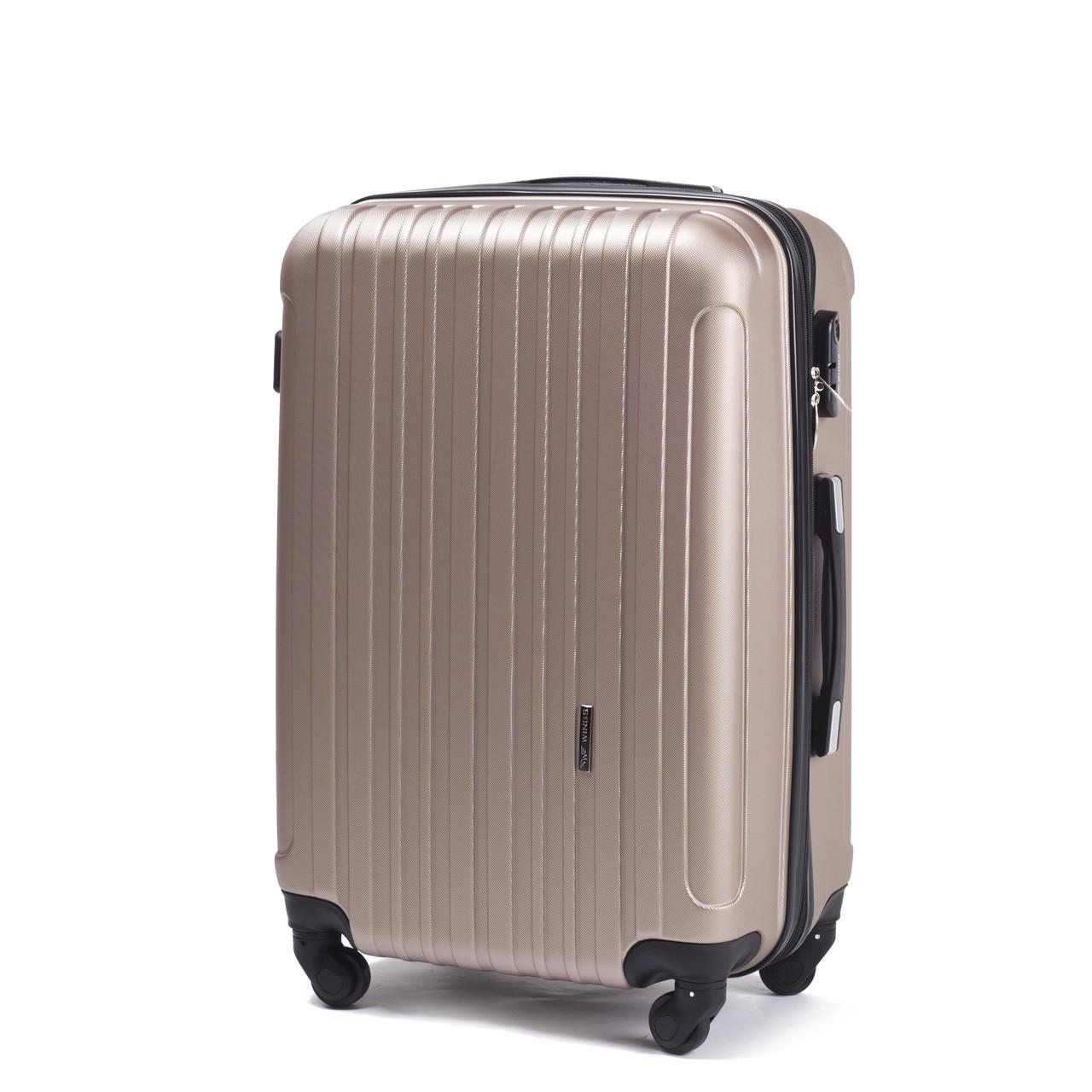 Большой пластиковый чемодан Wings 2011 на 4 колесах золотистый
