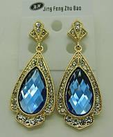 Сережки с голубыми камнями. Ювелирные украшения оптом. 211