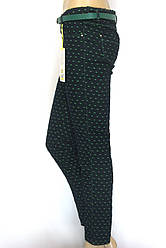 Жіночі штани зеленого кольору в горошок