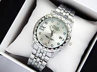 Женские наручные часы Rolex серебристого цвета с серебряным циферблатом, метки в виде звездочек, фото 1
