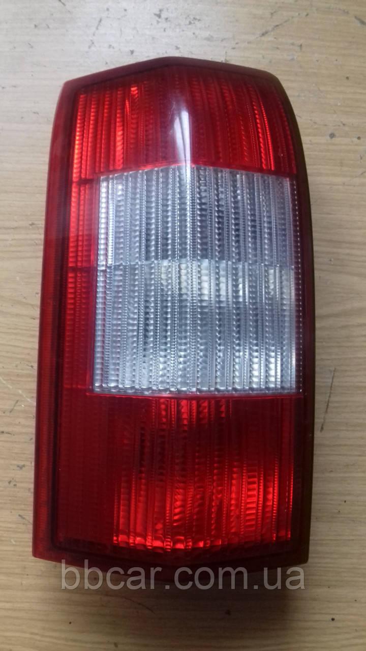 Задній ліхтар Opel Omega B універсал Hella 152 027  ( L )