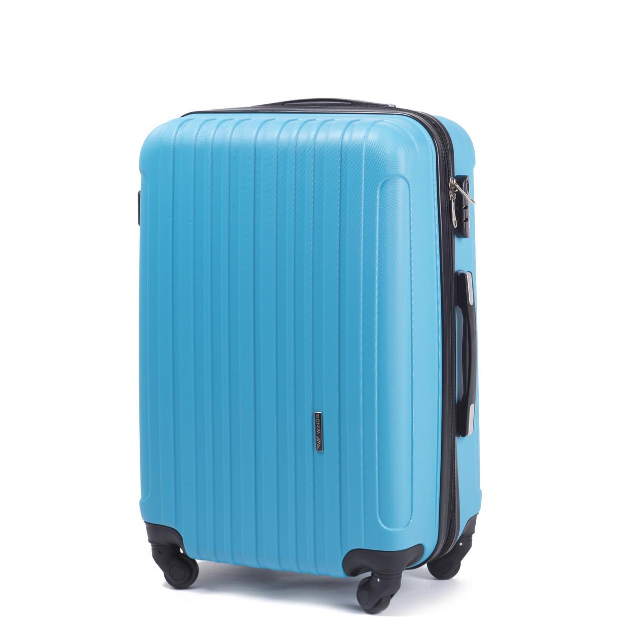 Большой пластиковый чемодан Wings 2011 на 4 колесах голубой