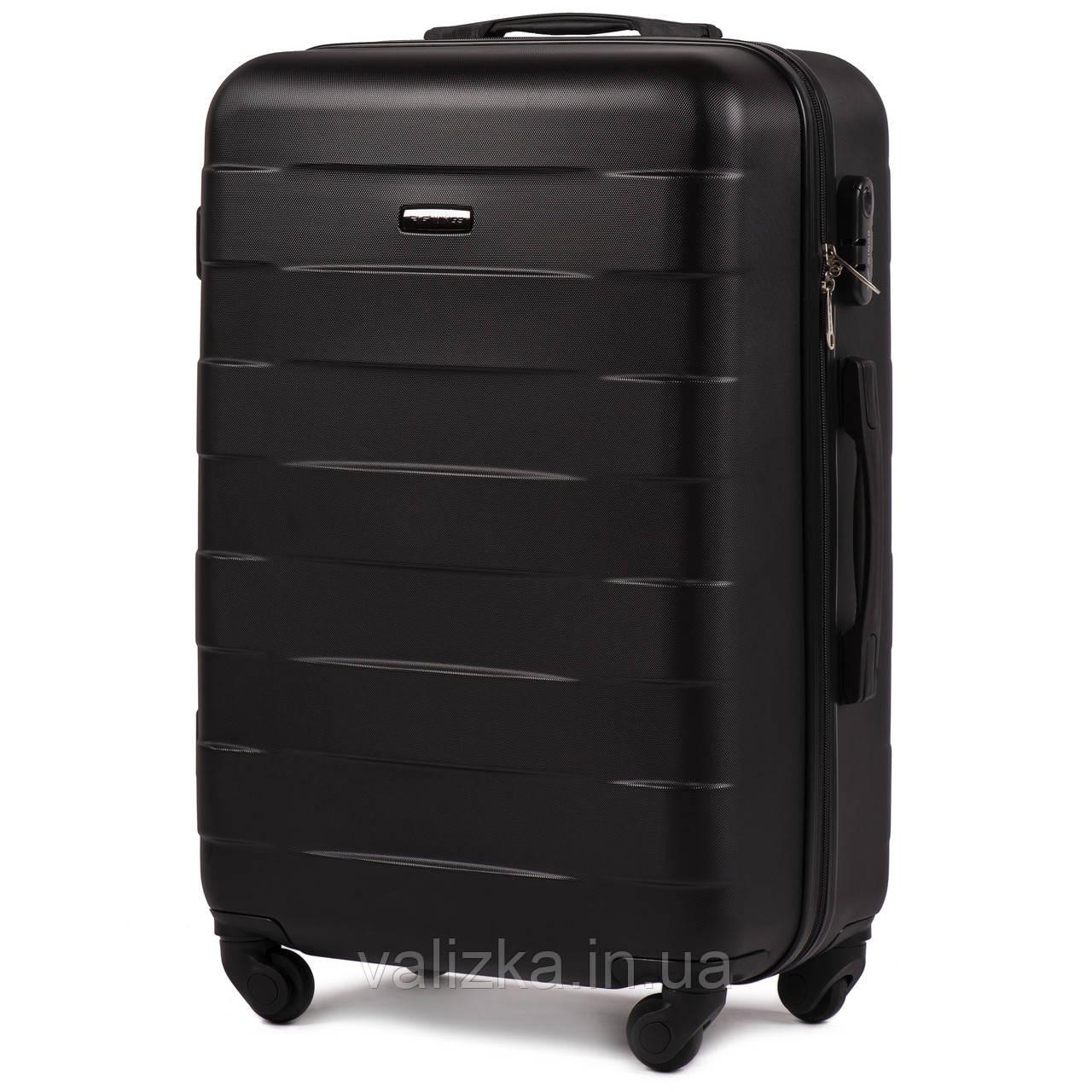 Пластиковый чемодан Wings 401 средний 4- колесный черный