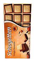 Schogetten Trilogia Noisettes, белый шоколад с грильяжем и фундуком, молочный шоколад с джандуей, молочный шоколад, 100г