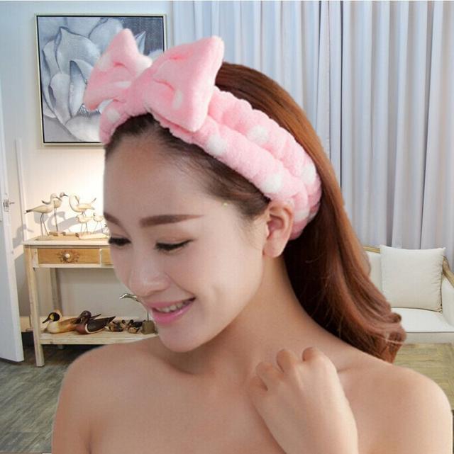 Плюшевая повязка на голову с розовым бантом