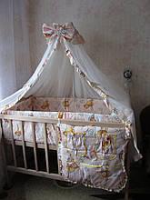 Захист і постільна в дитяче ліжечко