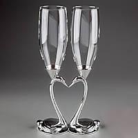 Свадебные бокалы для шампанского на мельхиоровых ножках в виде двух половинок в форме лебедей