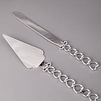 Нож и лопатка для свадебного торта с ручками в виде плетения с сердцами