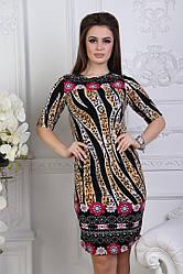Красивое платье-футляр на короткий рукав с оригинальными принтами