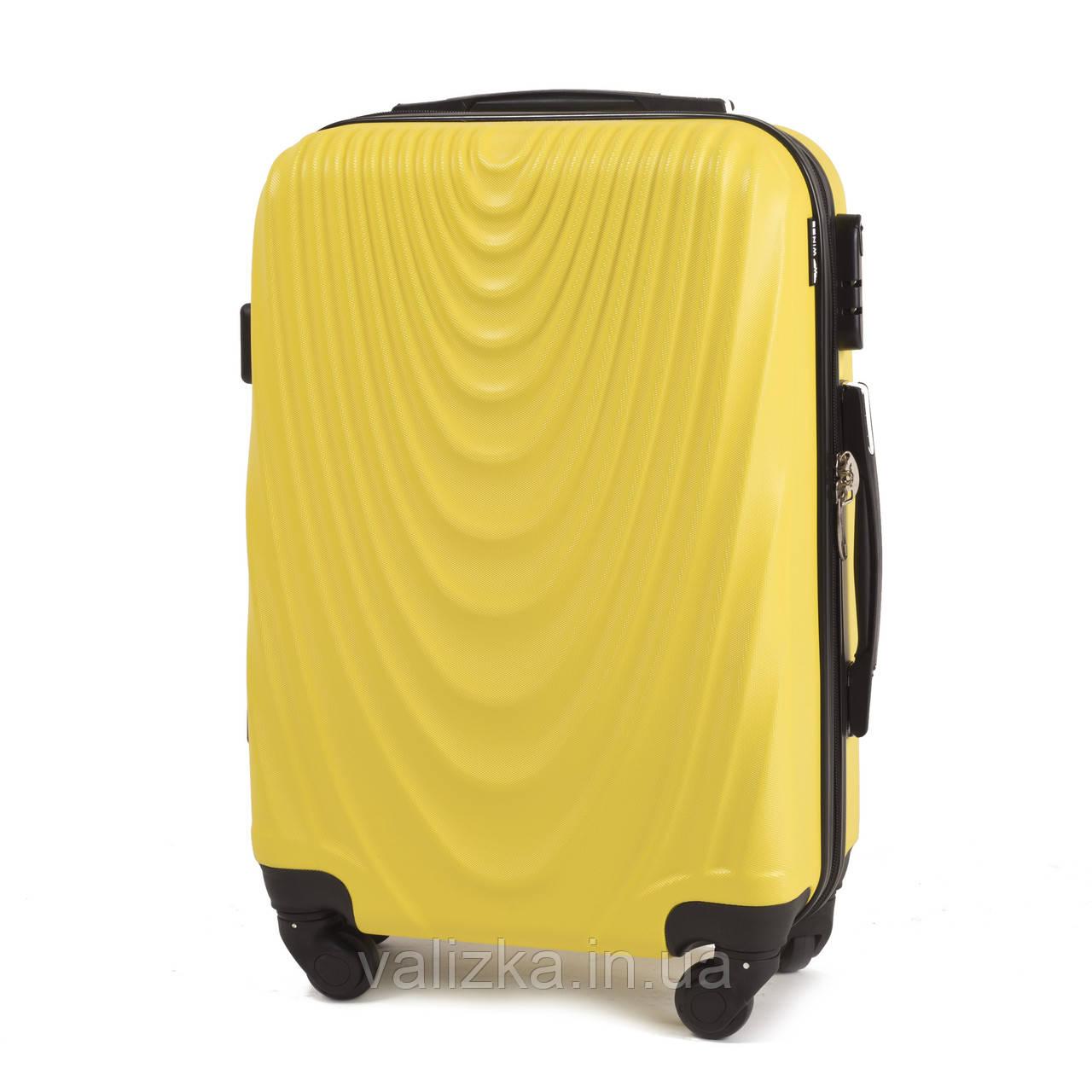 Чемодан из поликарбоната малый Wings 304 желтый на 4-х колесах