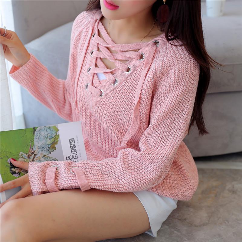 a0e87c468ad Женский удлинённый свитер туника с колечками на шнуровке розовый ...
