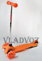 Детский самокат с наклонным поворотом руля Mid оранжевый