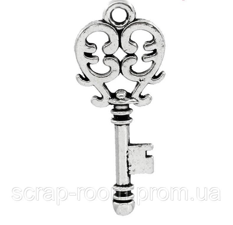 Подвеска металлическая Ключик серебро 26*11 мм