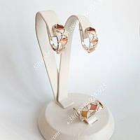 Срібні ювелірні прикраси з золотими пластинами