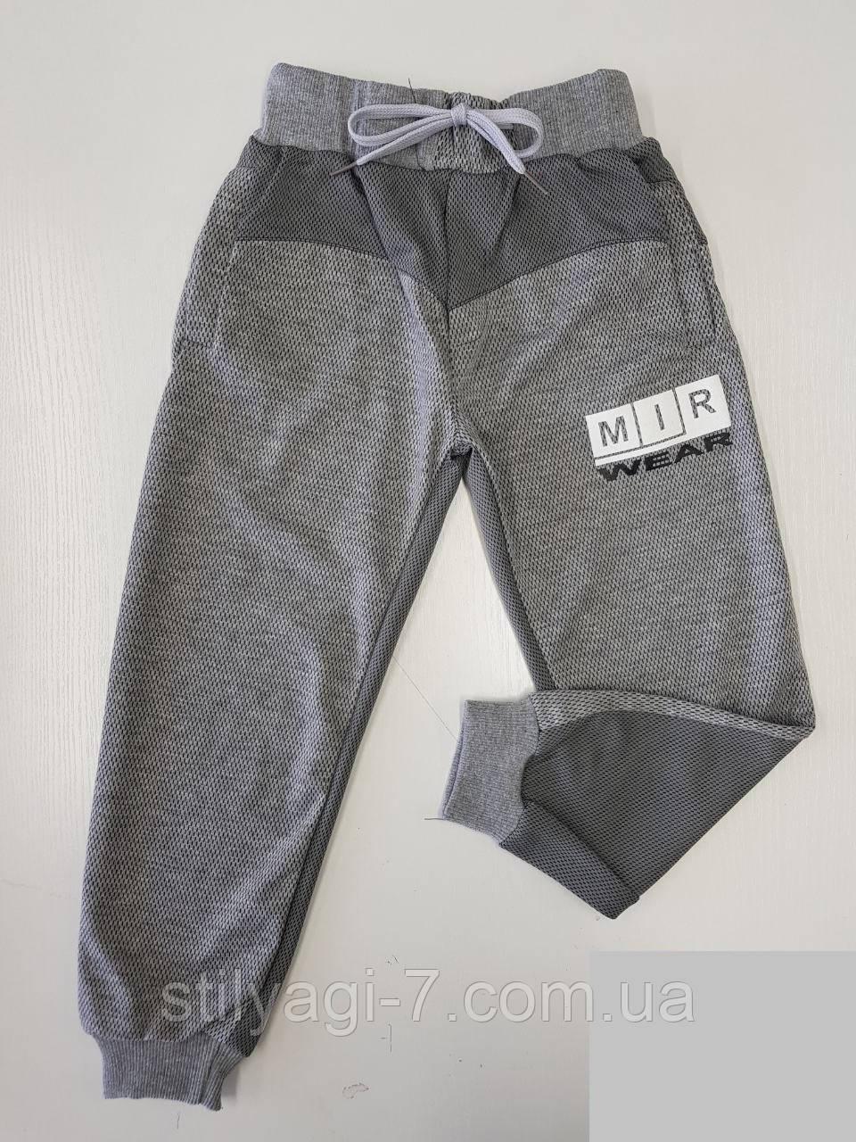 Спортивные штаны для мальчика на 13-16 лет серого цвета с надписью оптом