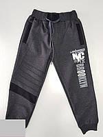Спортивные штаны для мальчика на 9-12 лет темно серого цвета с надписью оптом
