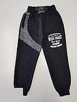 Спортивные штаны для мальчика на 5-8 лет черного цвета с надписью оптом