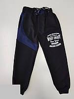 Спортивные штаны для мальчика на 13-16 лет черного цвета с надписью оптом