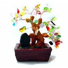 Декоративное дерево с камнями