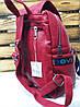 Стильный женский рюкзак красного цвета с оригинальной нашивкой и дополнительным отделом , фото 2
