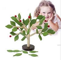 Детская игрушка. Дерево - развивающая игрушка