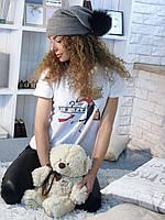 Женская вязаная шапка с меховым бубоном