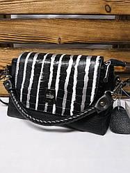 Женский клатч под рептилию черного цвета с белыми полосками и регулируемым ремешком