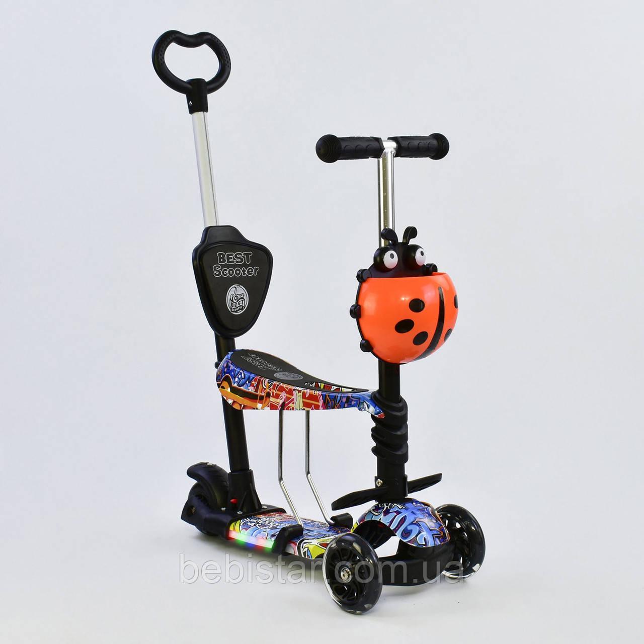 Самокат беговел коляска черно-оранжевый с ручкой подсветкой платформы и светящимися колесами малышам от 1года