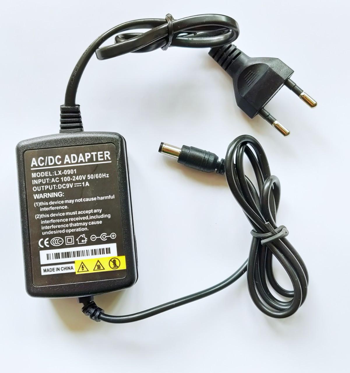 Импульсный адаптер питания 9В 1А (9Вт). Блок питания LX-0910