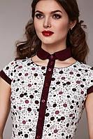 Блуза женская с коричневой отделкой.