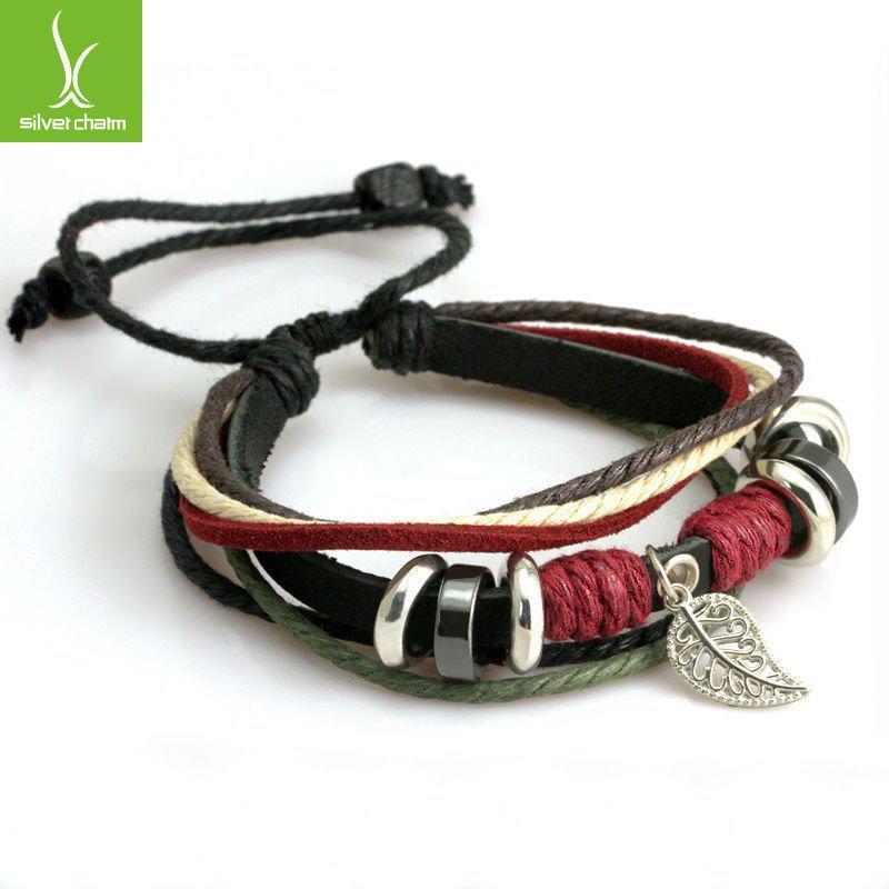 Шкіряний браслет чорний з намистинами і ажурним листочком