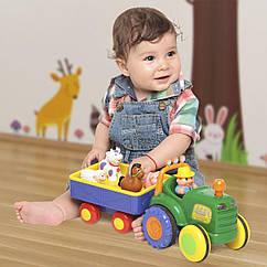 Іграшка на колесах - ТРАКТОР З ТРЕЙЛЕРОМ (світло, озвуч. українською мовою)  Kiddieland 024753