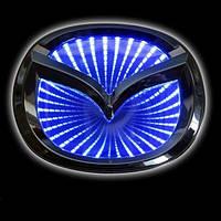 Автомобільна емблема Mazda 2/3 з підсвічуванням Slight 3D синя / Автоэмблема Мазда 2/3 с подсветкой 3D синяя