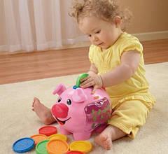 Музична свинка-скарбничка Fisher Price прокат в Харкові