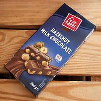 Шоколад молочный Fin Carre (с цельным лесным орехом) Германия 200г