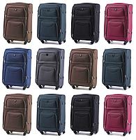 Средние чемоданы Wings 6802 на 4-х колесах
