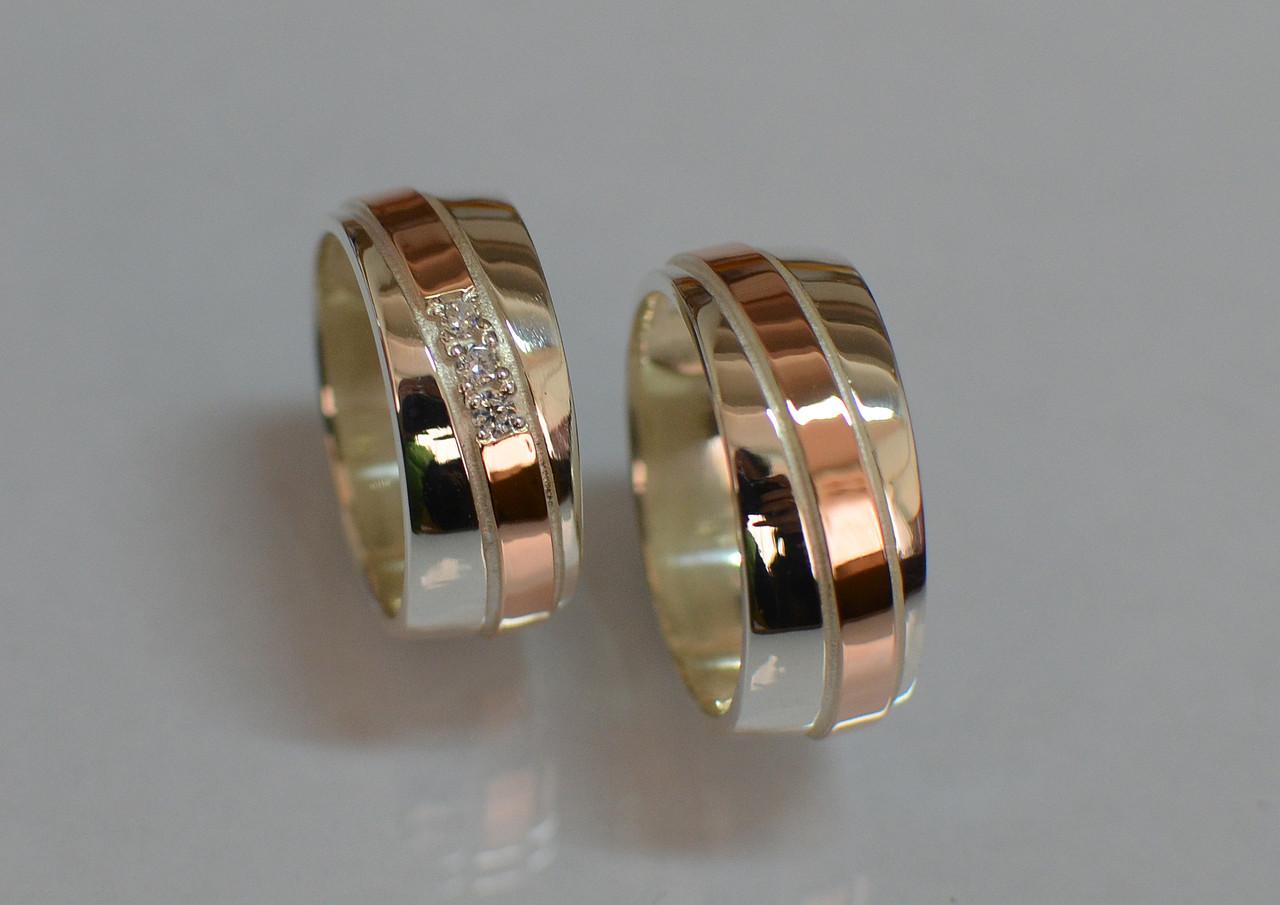 Пара обручальных колец из серебра с вставками из золота