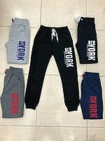 Спортивные штаны для мальчика на 9-12 лет черного, синего, серого цвета с надписью оптом