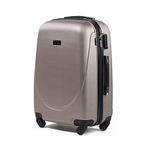 Большой пластиковый дорожный чемодан на 4 колесах фирма Wings (шампань)