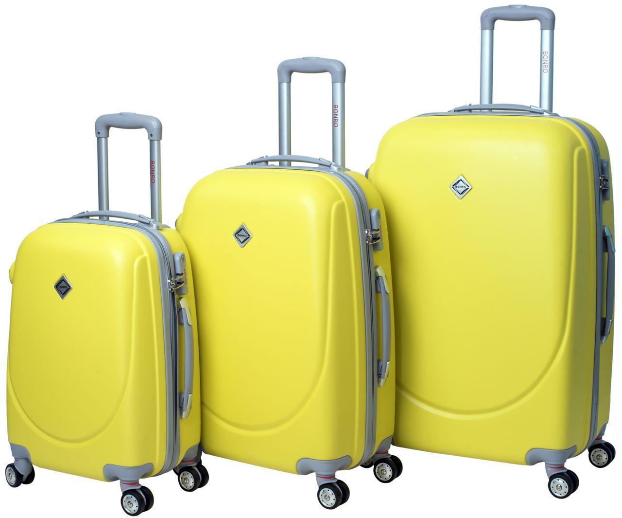 Набір валіз Bonro Smile пластикових з подвійними колесами Жовтий 3 шт