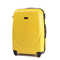 Большой пластиковый дорожный чемодан на 4 колесах фирма Wings (желтый)