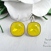 Потрясающие серебряные серьги с камнями Сваровски желтого цвета