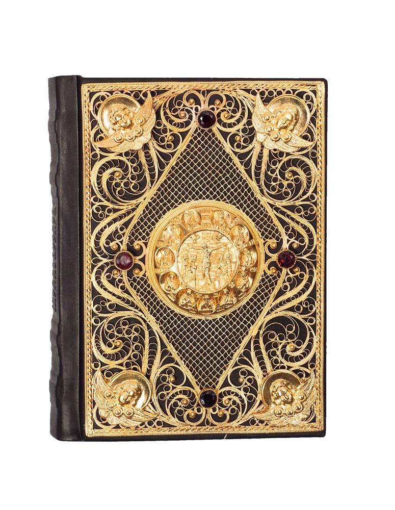 Православний молитвослов в шкіряній палітурці c філігранню покритою золотом і прикрашений гранатами