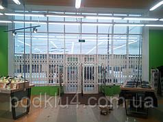 Раздвижные решетки для магазинов бытовых товаров