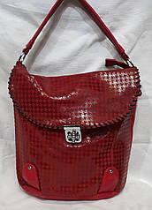 Женская сумка из кожзаменителя. Стильная сумка-мешок.